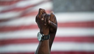 A year ago, thousands of marchers meet in Charleston, South Carolina, in a show of unity after nine black church parishioners were gunned down during a Bible study. (Associated Press/File)