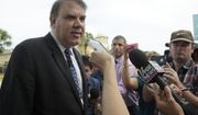 Rep. Alan Grayson, D-Fla., left, answers questions from reporters after being briefed by law enforcement officials following a shooting involving multiple fatalities at a nightclub in Orlando, Fla., Sunday, June 12, 2016. (AP Photo/Phelan M. Ebenhack)