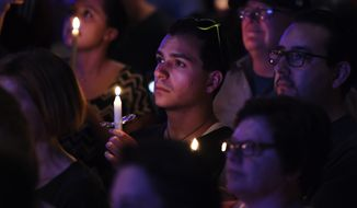 Speakers address a full room of supporters during a vigil for the Orlando shooting victims in Denver, Sunday, June 12, 2016. Denver community members gathered in support of the victims of the Orlando nightclub shooting in the early morning hours on Sunday. (Aaron Ontiveroz/The Denver Post via AP) MAGS OUT; TV OUT; INTERNET OUT; NO SALES; NEW YORK POST OUT; NEW YORK DAILY NEWS OUT; MANDATORY CREDIT