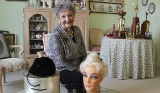 In this Jan. 19, 2011, file photo, retired hairstylist Margaret Vinci Heldt, poses for a photo at her apartment in Elmhurst, Ill. Heldt, who became a hairstyling industry celebrity after she created the famous beehive hairdo in 1960, has died at age 98. Ahlgrim Funeral Home said Monday, June 13, 2016, that Heldt died Friday at a senior living community. (AP Photo/Caryn Rousseau, File)