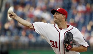 Washington Nationals starting pitcher Max Scherzer throws during the first inning of a baseball game against the Chicago Cubs at Nationals Park, Monday, June 13, 2016, in Washington. (AP Photo/Alex Brandon)