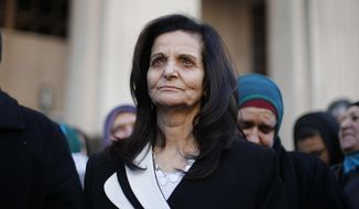 Rasmea Odeh listens to supporters after leaving federal court in Detroit, in this March 12, 2015, file photo. (AP Photo/Paul Sancya, File)