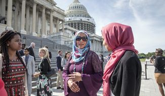 Members of the Congressional Muslim Staff Association, the LGBT Congressional Staff Association, and members of Congress begin to assemble for a prayer and moment of silence on the steps of the Capitol to stand in solidarity with the Orlando community and to remember the victims of Sunday's shooting at an LGBT night club, in Washington, Monday, June 13, 2016. (AP Photo/J. Scott Applewhite)