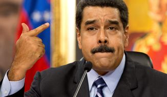 Venezuela's President Nicolas Maduro speaks during a press conference at the Miraflores presidential palace in Caracas, Venezuela, Tuesday, May 17, 2016. Maduro accused the United States of sabotage plans against Venezuela, saying they aim to create a scenario of violence to justify a foreign military intervention to remove him from power. (AP Photo/Ariana Cubillos) ** FILE **