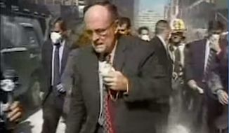 """Former New York City Mayor Rudy Giuliani in the dust of Manhattan on the morning of 9/11 attacks. He has decried President Obama's apparent inability to say the words """"Islamic terrorism."""" (ABC News)"""