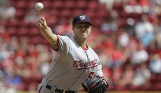 Washington Nationals relief pitcher Jonathan Papelbon throws in the ninth inning of a baseball game against the Cincinnati Reds, Sunday, June 5, 2016, in Cincinnati. The Nationals won 10-9. (AP Photo/John Minchillo)