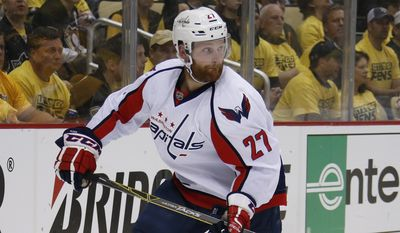 """In this May 2, 2016 file photo, Washington Capitals' Karl Alzner (27) skates during the first period of Game 3 in an NHL hockey Stanley Cup Eastern Conference semifinals against the Washington Capitals in Pittsburgh. Alzner had sports hernia surgery, Wednesday, June 15, 2016, and the team says it expects him to be  """"completely healthy"""" before the start of next season. (AP Photo/Gene J. Puskar)"""