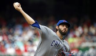 Chicago Cubs starting pitcher Jason Hammel throws during the fourth inning of a baseball game against the Washington Nationals at Nationals Park, Wednesday, June 15, 2016, in Washington. (AP Photo/Alex Brandon)