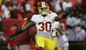 Washington Redskins strong safety Kyshoen Jarrett (30) warms up on the field before the first half of an NFL football game against the Atlanta Falcons, Sunday, Oct. 11, 2015, in Atlanta. (AP Photo/Brynn Anderson)