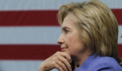 Democratic Presidential candidate Hillary Clinton listens to a question during a panel discussion on national security, Wednesday, June 15, 2016, at the Virginia Air and Space Museum in Hampton, Va. (AP Photo/Steve Helber)