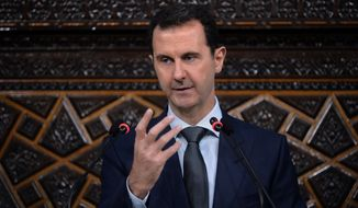 Syrian President Bashar Assad addresses the newly-elected parliament in Damascus, Syria, on June 7. (Associated Press)