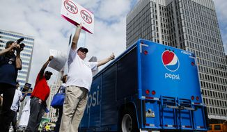 Opponents of a proposed sugary drink tax demonstrate outside City Hall in Philadelphia on June 8. (Associated Press)
