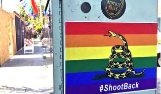 A new take on the Gadsden flag is showing up in West Hollywood, Calif., which urges the LGBT community to arm itself for self defense. (KTLA-5 screenshot)