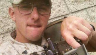 An investigation has been launched over an image, shared online showing an active-duty Marine with his finger on the trigger of a rifle, captioned: 'Coming to a gay bar near you!' (Image: Facebook, via NY Daily News)