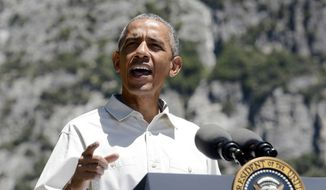 President Barack Obama gives some remarks about the importance of the National Park Service during an event near Cook's Meadow in Yosemite National Park, Saturday, June 18, 2016. (Craig Kohlruss/The Fresno Bee via AP)