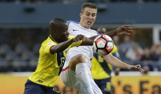 United States' Matt Besler, right, and Ecuador's Enner Valencia fight for the ball during a Copa America Centenario quarterfinal soccer match, Thursday, June 16, 2016 at CenturyLink Field in Seattle. The U.S. won the match 2-1. (AP Photo/Elaine Thompson)