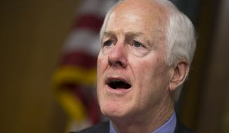 FILE - In this June 7,2016 file photo, Sen. John Cornyn, R-Texas speaks on Capitol Hill in Washington. Democrats get their long-sought votes on gun control a week after the massacre in Orlando, Florida, but the prospects for any election-year changes in the nations laws are dim. Cornyn is pushing a measure that would allow the government to delay a gun sale to a suspected terrorist for 72 hours, but require prosecutors to go to court to show probable cause to block the sale permanently.  (AP Photo/Evan Vucci, File)