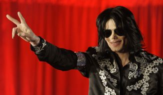 In this March 5, 2009, photo U.S. singer Michael Jackson speaks at a press conference at the London O2 Arena. On June 20, 2016, Radar Online reported that a 2003 police raid uncovered a cache of disturbing photographic images at Mr. Jackson's Neverland Ranch. Authorities familiar with the case say the report is inaccurate. (AP Photo/Joel Ryan, File) **FILE**