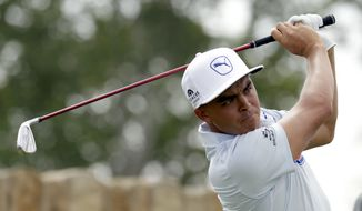 Rickie Fowler watches his tee shot on the ninth hole during a practice round for the U.S. Open golf championship at Oakmont Country Club on Wednesday, June 15, 2016, in Oakmont, Pa. (AP Photo/Charlie Riedel)