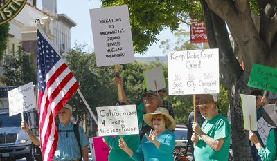In this photo taken, March 17, 2016, people rally in front of the San Luis Obispo County government building in support of Diablo Canyon nuclear power plant in San Luis Obispo, Calif. Pacific Gas & Electric Co. and environmental groups said Tuesday, June 21, 2016, that they've reached an agreement that will close the Diablo Canyon plant, California's last nuclear power plant, by 2025. (David Middlecamp/The Tribune (of San Luis Obispo) via AP) MANDATORY CREDIT