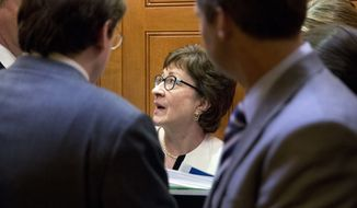 Sen. Susan Collins, R-Maine, center, takes the elevator to a news conference on Capitol Hill, Tuesday, June 21, 2016 in Washington. (AP Photo/Alex Brandon)