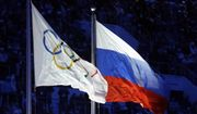 FILE - In this Feb. 7, 2014 file photo the Russian and the Olympic flags wave during the opening ceremony of the 2014 Winter Olympics in Sochi, Russia. Olympic leaders met Tuesday, June 21, 2016 to consider further steps to crack down on doping ahead of the games in Rio de Janeiro in the wake of the ban on Russian track and field athletes.  (AP Photo/Patrick Semansky, file)