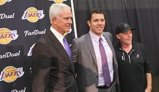 Los Angeles Lakers general managerMitch Kupchak, left, and team owner Jim Buss, right, introduce the team's new coach, Luke Walton, center, during a news conference in El Segundo, Calif., Tuesday, June 21, 2016.  (AP Photo/Greg Beacham)