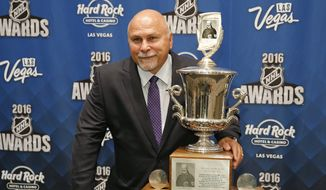 Washington Capitals head coach Barry Trotz poses with the Jack Adams Award after winning the award at the NHL Awards show, Wednesday, June 22, 2016, in Las Vegas. (AP Photo/John Locher)