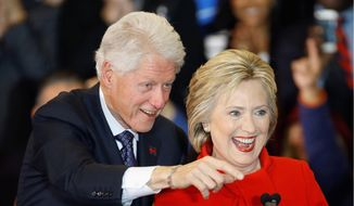 """Former President Bill Clinton will host a fundraiser for his wife in Chicago, with a price per ticket for a """"host"""" costing $50,000. A """"champion"""" can get through the front door for $33,400. (Associated Press)"""