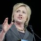 Democratic presidential candidate Hillary Clinton tacked left on the economy on Wednesday, slamming Wall Street and touting debt-free college. (Associated Press)