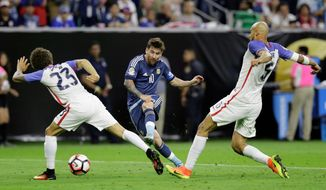 Argentina's Lionel Messi takes a shot on goal past the U.S.' Fabian Johnson (23) and Matt Besler during a Copa America Centenario semifinal in Houston on Tuesday. The 4-0 score is a reminder of the divide between the U.S. and soccer'se elite. (Associated Press)