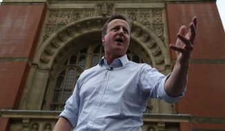 Britain's Prime Minister David Cameron delivers a speech at a Britain Stronger In Europe event during campaigning for people to vote to remain inside the EU in Birmingham, England,  Wednesday June 22, 2016.  On Thursday Britain votes in a national referendum on whether to stay inside the EU, a momentous decision with far-reaching implications for Britain and Europe. (Geoff Caddick / Pool via AP)