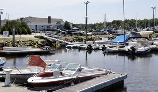 In this Monday, June 20, 2016 photo, boats are docked at the Westerly Yacht Club in Westerly, R.I. Wives can join the club as associate, non-voting members, but unmarried women can't. A vote to change the nearly century-old policy failed last week, with 171 men voting to uphold it. Women, and many men, are not happy. (AP Photo/Elise Amendola)