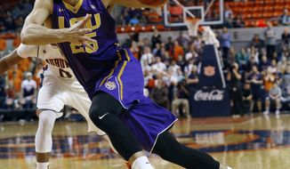 FILE - In this Feb. 2, 2016 file photo, LSU's Ben Simmons drives to the basket against Auburn during the first half of an NCAA college basketball game in Auburn, Ala. Ben Simmons and Brandon Ingram look to be the first two picks in the NBA draft, leaving most of the drama Thursday night around who be the No. 3 pick. (Todd J. Van Emst/Opelika-Auburn News via AP, File) MANDATORY CREDIT