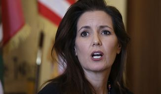 FILE - In this June 15, 2016, file photo Oakland Mayor Libby Schaaf answers questions during a news conference at City Hall in Oakland, Calif. Schaaf is a trained lawyer who left her legal career years ago for grassroots community service in Oakland that eventually led to her election as mayor of the long-troubled California city. Now, midway through her first term, she is facing the toughest trial of her political career with the scandal-ridden Oakland Police Department providing a seemingly daily dose of embarrassment for her and the city. (AP Photo/Eric Risberg, File)