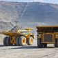 Giant copper ore trucks in open pit mine (Photo: Shutterstock)
