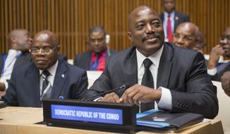 Joseph Kabila (right), President of the Democratic Republic of the Congo, during the fourth meeting of the regional oversight mechanism of the Peace, Security and Cooperation Framework for the Democratic Republic of the Congo and the Region on Sept. 22, 2014 at the United Nations in New York City. (UN Photo/Amanda Voisard)