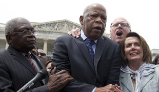 """From left, Rep. John Lewis, D-Ga., center, accompanied by, from left, House Assistant Minority Leader Rep. James Clyburn of S.C., Rep. Joseph Crowley, D-N.Y., and House Minority Leader Nancy Pelosi of Calif., sing """"We Shall Overcome"""" on Capitol Hill in Washington, Thursday, June 23, 2016, after House Democrats ended their sit-in protest. (AP Photo/Carolyn Kaster)"""
