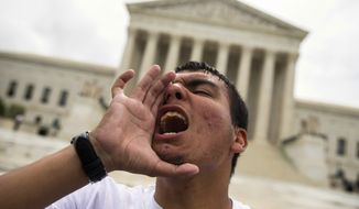 Gerson Quinteron of Washington yells during a demonstration on immigration at the Supreme Court on Thursday. A tie vote by the Supreme Court is blocking President Barack Obama's immigration plan that sought to shield millions living in the U.S. illegally from deportation. The justices' one-sentence opinion effectively kills the plan for the duration of Obama's presidency. (Associated Press)