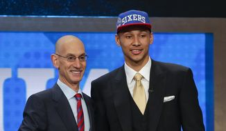 LSU's Ben Simmons poses for a photo with NBA Commissioner Adam Silver after being selected as the top pick by the Philadelphia 76ers during the NBA basketball draft, Thursday, June 23, 2016, in New York. (AP Photo/Frank Franklin II)