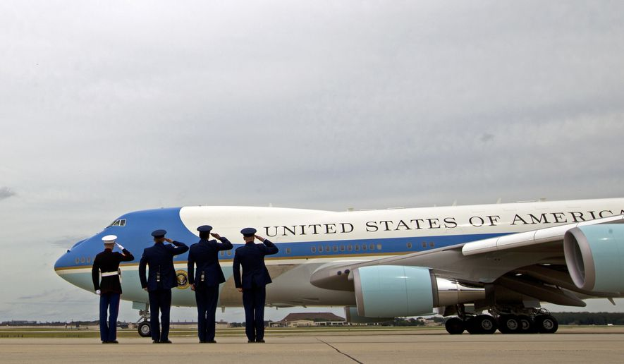 Military Personnel Salutes As Air Force One With President Barack Obama Aboard Departs