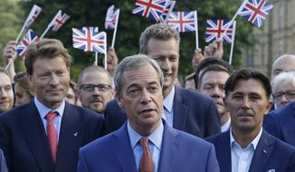 Nigel Farage, the leader of the UK Independence Party, speaks to the media on College Green in London on June 24, 2016. (Associated Press)