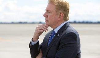 Ed Murray, mayor of Seattle waits for President Obama to arrive at SeaTac on Friday, June 24, 2016. (Mike Siegel/The Seattle Times via AP, Pool)