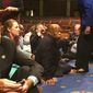 In this photo provided by Rep. John Yarmuth, D-Ky., Democratic members of Congress, including Rep. John Lewis, D-Ga., center, and Rep. Joe Courtney, D-Conn., left, participate in sit-in protest on the floor of the House on Capitol Hill in Washington on Wednesday, June 22, 2016 seeking a vote on gun control measures. (Rep. John Yarmuth via AP)