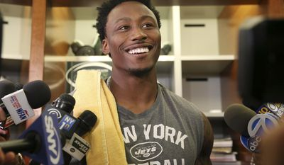 FILE - In this June 1, 2016, file photo, New York Jets wide receiver Brandon Marshall answers a question as he stands in the locker room after NFL football practice in Florham Park, N.J. Marshall is serving up some rather interesting, if not particularly palatable, food combinations for his offseason diet. He is trying to lose a few pounds, at coach Todd Bowles' request, before the team begins training camp next month. (AP Photo/Mel Evans, File)