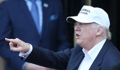 "The presumptive Republican presidential nominee  Donald Trump arrives at his revamped Trump Turnberry golf course in Turnberry, Scotland, on Friday June 24, 2016. Trump saluting the United Kingdom's vote to leave the European Union, saying ""they took back their country, it's a great thing."" Trump arrived at his Turnberry golf course in Scotland a day after the so-called Brexit vote. (Andrew Milligan/PA via AP)"