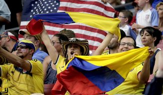 USA and Colombia fans watch warm up's prior to the Copa America Centenario third-place soccer match at University of Phoenix Stadium, Saturday, June 25, 2016, in Glendale, Ariz. (AP Photo/Matt York)