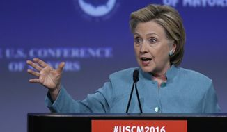 Democratic presidential candidate Hillary Clinton addresses the the U.S. Conference of Mayors in Indianapolis, Sunday, June 26, 2016. (AP Photo/Michael Conroy)