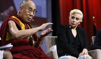 Lady Gaga listens as the Dalai Lama speaks during a question-and-answer session at the the U.S. Conference of Mayors in Indianapolis, Sunday, June 26, 2016. (AP Photo/Michael Conroy)