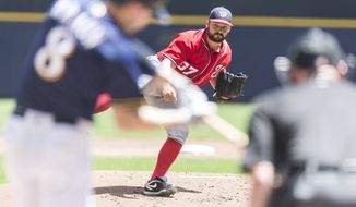 Washington Nationals' Tanner Roark pitches to a Milwaukee Brewers' batter during the first inning of a baseball game Sunday, June 26, 2016, in Milwaukee. (AP Photo/Tom Lynn)